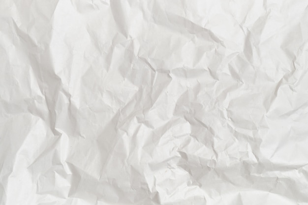 The background and texture of white crumpled paper.