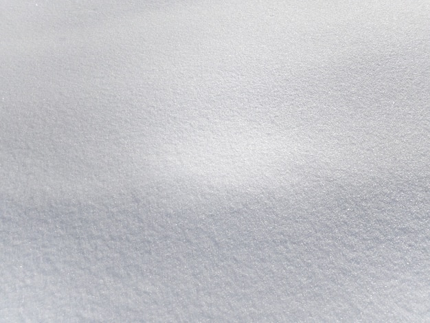 Background texture of white fresh snow sparkling in the sun, copy space, mobile photo