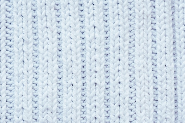 Background and texture white knitted woolen fabric.