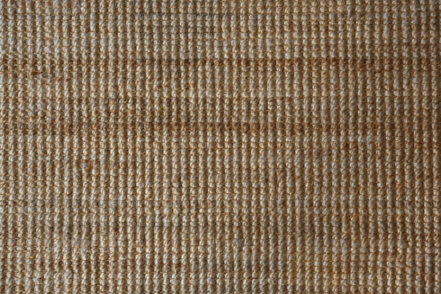 Background and texture of yellow sisal or jute mat, wool