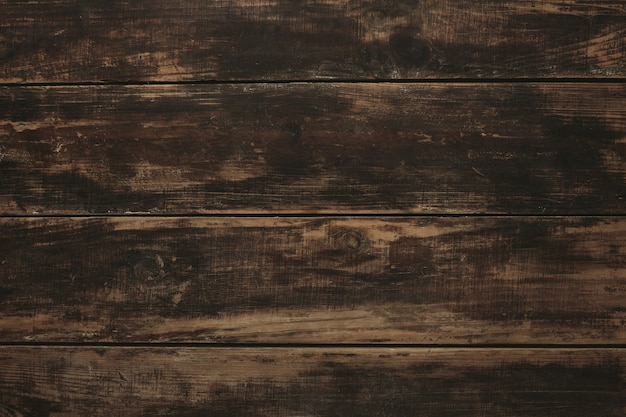 Background, top view of old vintage aged brushed brown wooden table, rich texture