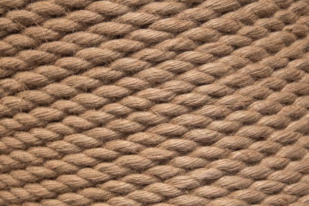 背景ツイストロープ。ロープの背景-テクスチャ。茶色のロープロープのテクスチャ。