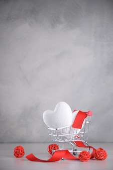 Background for valentine's day greeting card.valentines day concept.hearts in a shopping cart.