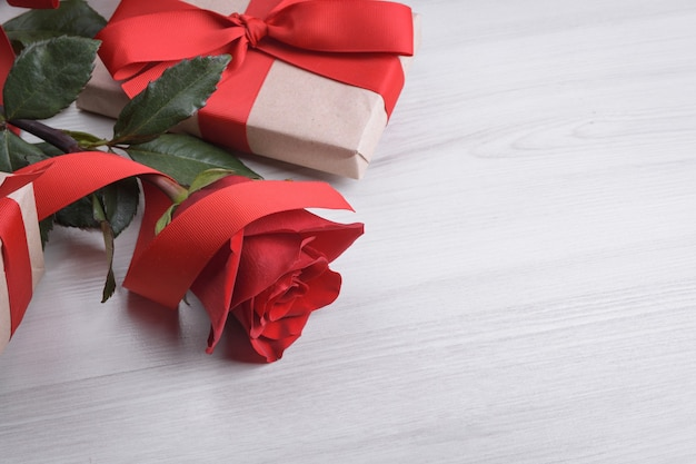 Background for valentine's day greeting card.valentines day concept.red, beautiful blooming rose. close up.