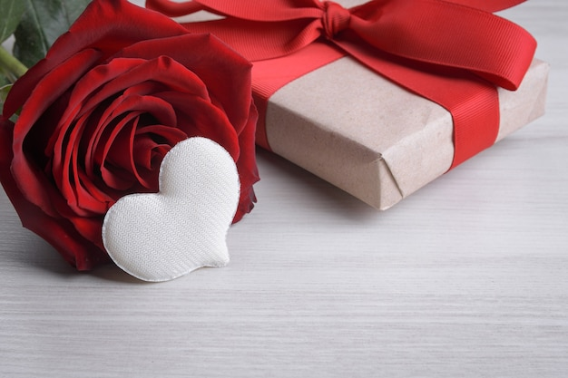 Background for valentine's day greeting card.valentines day concept.red gift ribbons, gifts, hearts on a wooden background.