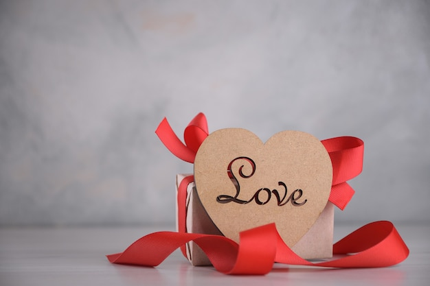 Background for valentine's day greeting card.valentines day concept.wooden heart with the inscription love.