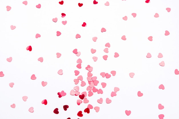 Background for valentine's day light shade with red hearts.