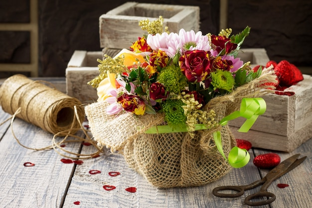 Background valentine's day or wedding. basket bouquet of roses and chrysanthemums.
