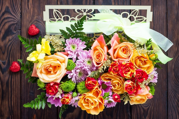Background of valentine's day or wedding day. beautiful bouquet of flowers as a gift.