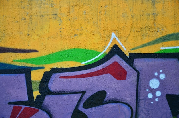 Background  of the wall decorated with colorful abstract graffiti. street art