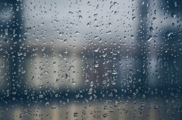 Background and wallpaper by rainy drop and water drops on window glass.