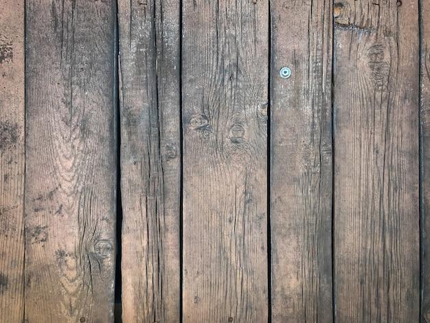 Sfondo di una superficie in legno stagionato