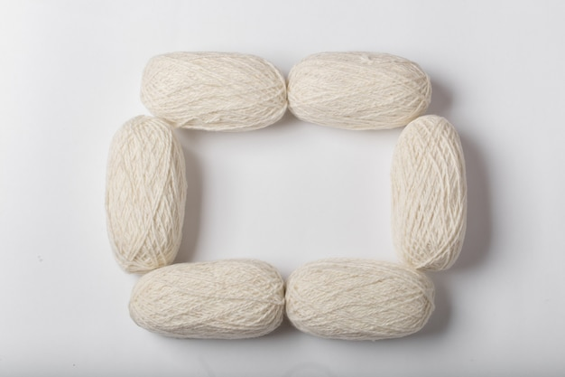 Background of the white yarn frame