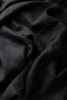 Background with a black linen fabric, top down view image