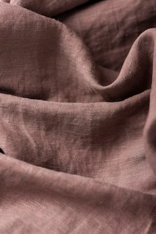 Background with a brown linen fabric, top down view image