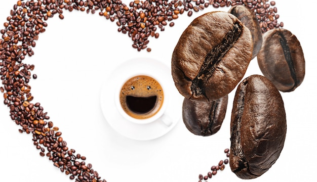 Background with coffee beans falling on a cup of coffee