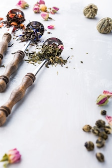 Background with different types of tea leaves