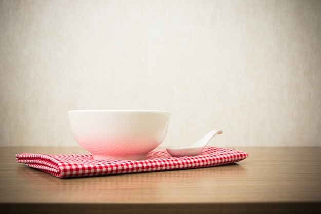 Background with empty bowl on wooden table