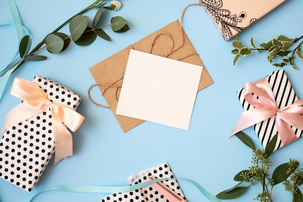 Background with envelope, greeting card and flowers.