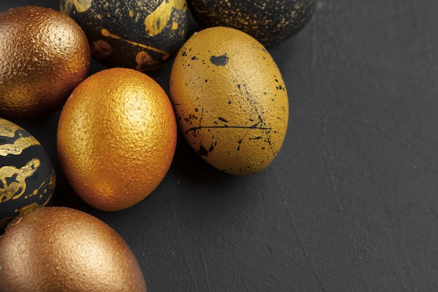 Background with golden decorated easter eggs