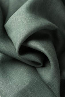 Background with a green linen fabric, top down view image