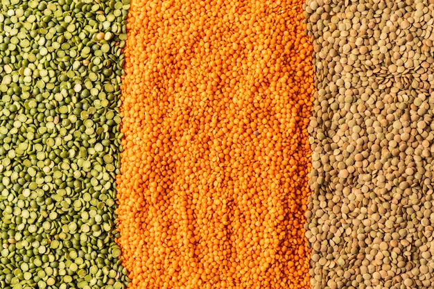 Background with lentils seeds of annual legume plant, they are rich in vegetable protein.