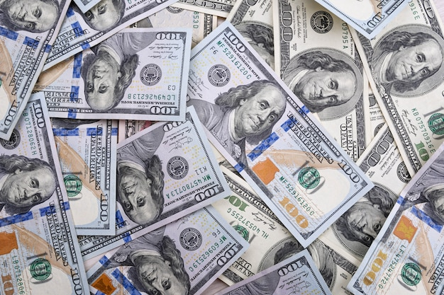 Фон с деньгами американские сто долларовых купюр