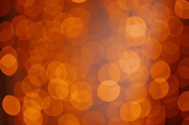クリスマス休暇中の天然ゴールドのボケ味の焦点がぼけた輝きの装飾の背景魔法の光沢のある...