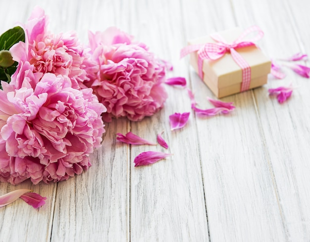 Background with peonies and gift box