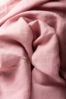 Background with a pink linen fabric, top down view image