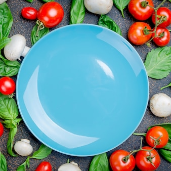 Background with tomatoes, champignons and basil leaves