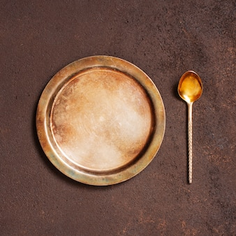 Background with vintage metal plate and spoon