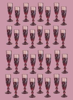 Background with wine glasses in pink colors