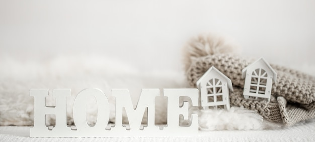 Background with wooden inscription home. decorative letters forming word home.