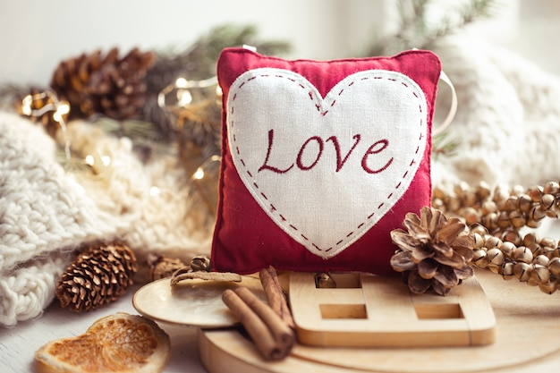 Background with the word love embroidered on a small pillow. valentine's day concept.