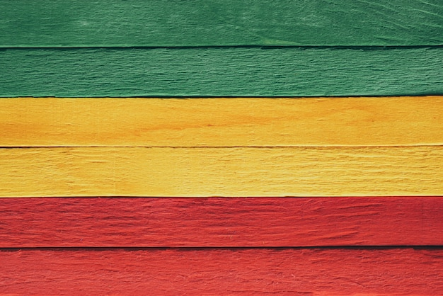 Background wood green, yellow, red old retro vintage style, rasta reggae flag
