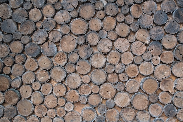 Background of wood. many logs of trees. lumber, firewood for winter