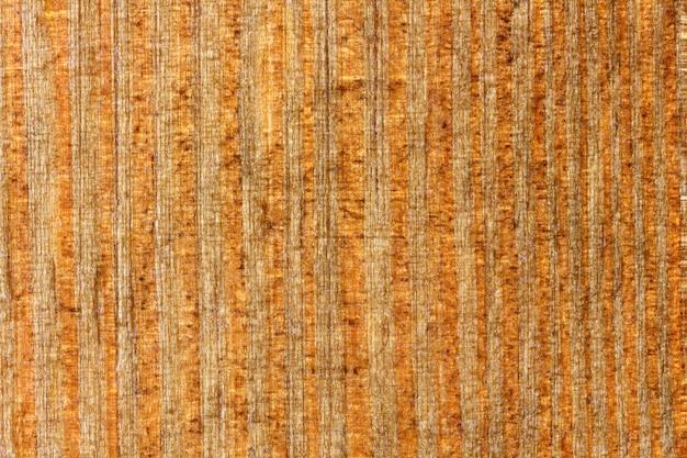 배경 나무 오래 된 표면 래커 오렌지 세로 섬유 구조.