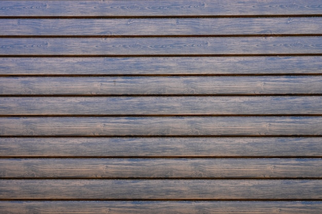Background of wooden dark lacquer strips