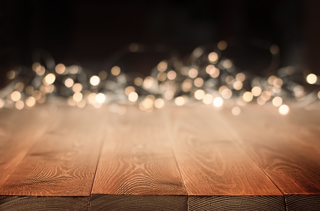 Background wooden table and golden bokeh