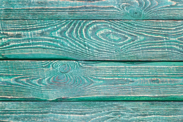 Background of wooden texture boards with the rest of the old green paint.