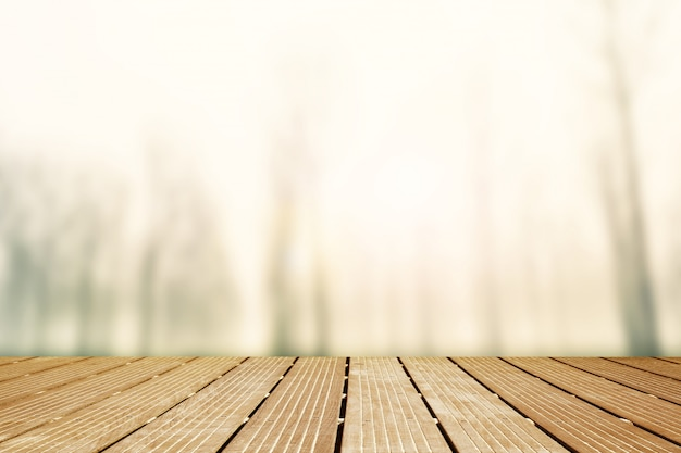 Background. wooden walkway with blurred panorama of foggy countryside