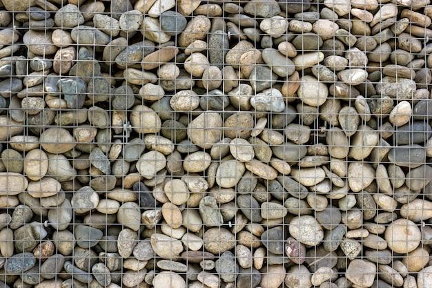 背景コレクション-海の小石で作られた装飾的な石の壁