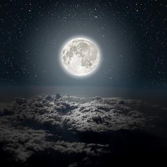 背景星と月と雲のある夜空木nasaによって提供されたこの画像の要素