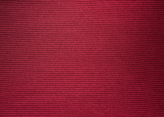 Backgrounds and textures. maroon knitted fabric. fine knit.