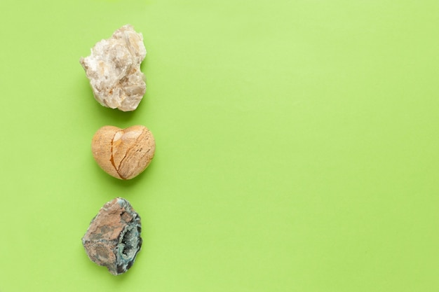 Backgrounds and textures, nature concept - rocks and minerals. different minerals and heart stone on green background.