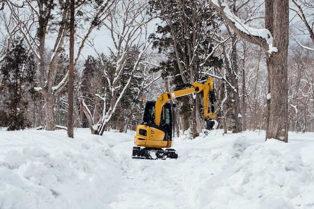 Backhoe in snow at togakushi shrine, japan
