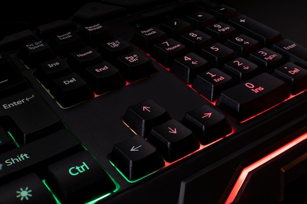 Backlit black gaming keyboard in different colors.