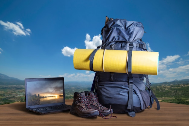 Backpack, trekking shoes, notebook, traveler equipment