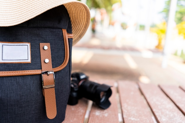Backpack with hat and camera for traveler